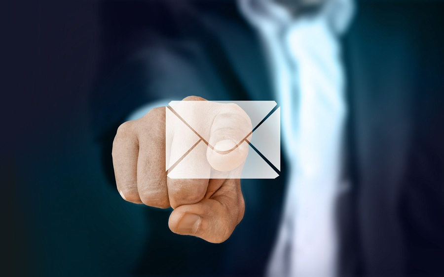 Man selecting email icon on a screen using his finger